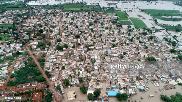 An aerial view of Kamtagi village submerged in floodwaters in Bagalkot district in Karnataka about 460 kms of the South Indian city of Bangalore on...