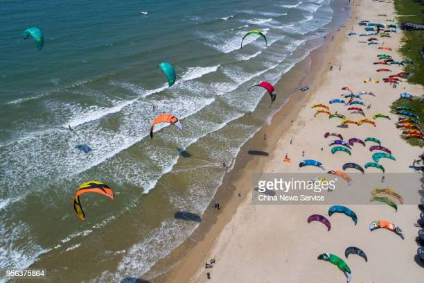 An aerial view of kiteboards competing in the kitesurfing match of the 2018 Buenos Aires Summer Youth Olympic Game Qualification during the 2018 Boao...