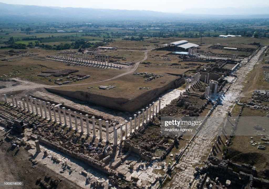 An aerial view of Laodicea Ancient City in 6 kilometers north of Turkey's Denizli on July 19, 2018. Ancient city was constructed by Antiochus II Theos of Seleucid Empire for his wife during the Helenistic period in mid 3 B.C. City includes Christianity's one of first seven churches. City became a religious center as it reach a level of metropolis in the early Byzantine period. Laodicea's significant structures follow 285 meter long and 70 meter wide Anatolia's biggest stadium, two theatres, four bathhouse complexes, five agoras, five nymphaeums, two monumental entrance gates, Bouleuterion temples, peristyle houses, latrina, churches and monumental streets.