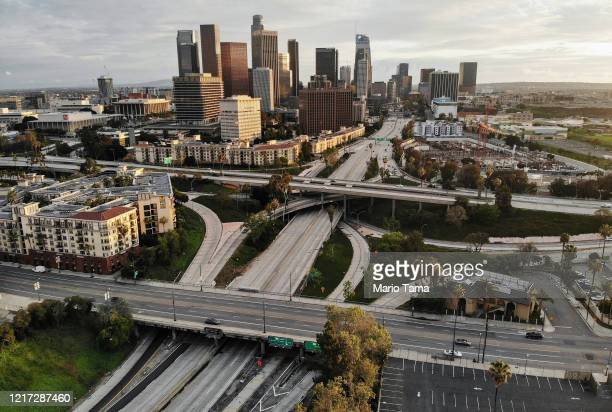 An aerial view of light traffic before sunset on the I110 and SR101 freeways and Sunset Boulevard amid the coronavirus pandemic on April 6 2020 in...