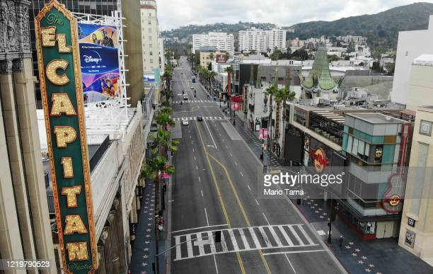 An aerial view of light traffic on Hollywood Boulevard midmorning amidst the coronavirus pandemic on April 18 2020 in Los Angeles California...