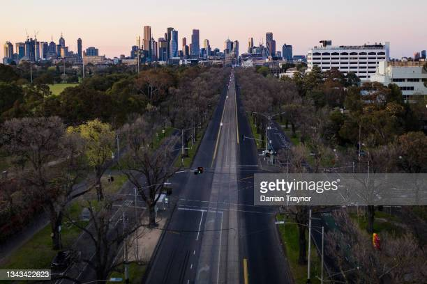 An aerial view of looking south along a normally busy Royal Parade, Carlton on September 28, 2021 in Melbourne, Australia. Lockdown restrictions...