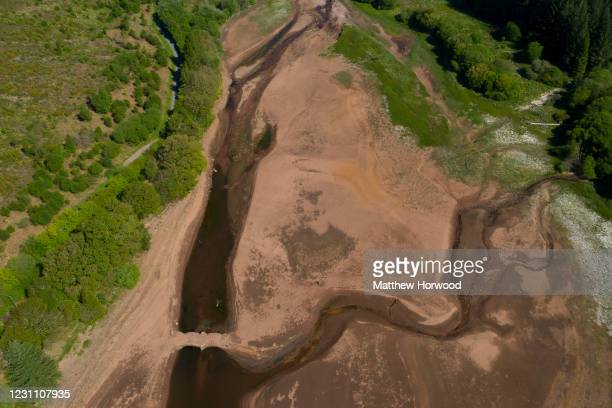 An aerial view of low water levels in the Llwyn-on reservoir in Taf Fawr valley on May 29, 2020 in Merthyr Tydfil, United Kingdom. The Met Office...