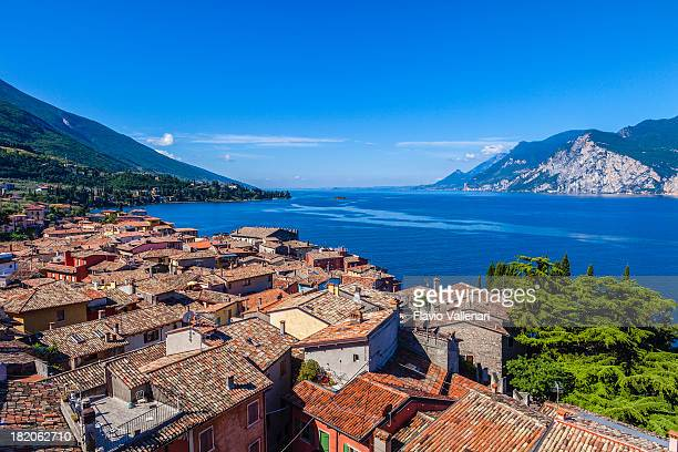an aerial view of malcesine and lake garda - lake garda stock pictures, royalty-free photos & images