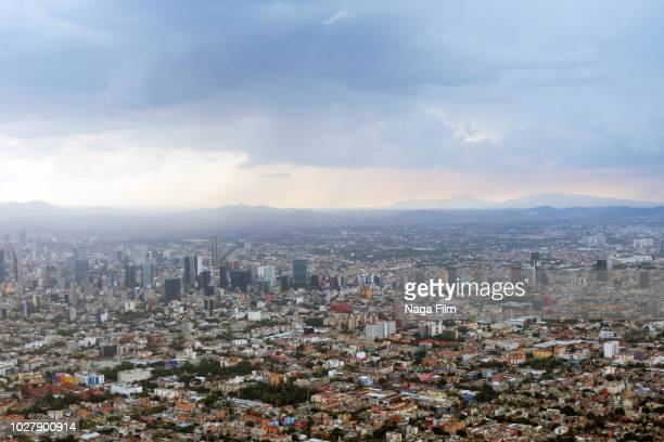 an aerial view of mexico city in the summertime. - mexico city stock pictures, royalty-free photos & images