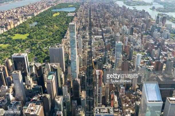 an aerial view of midtown and central park on june 14, 2019 in new york city. - パークアベニュー ストックフォトと画像