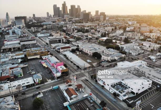 An aerial view of mostly empty streets and parking lots with the downtown skyline in the background amid the coronavirus pandemic on April 4, 2020 in...