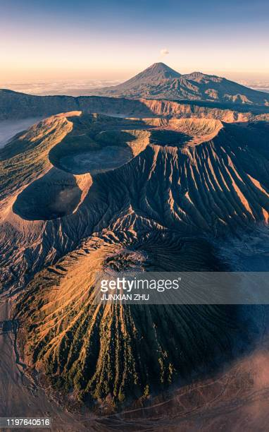 an aerial view of mount bromo volcano (gunung bromo) in east java indonesia. - bromo crater stock pictures, royalty-free photos & images