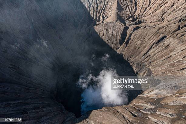 an aerial view of mount bromo volcano (gunung bromo) in east java indonesia. - bromo tengger semeru national park stock pictures, royalty-free photos & images