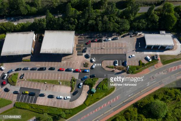 An aerial view of nearly 40 cars queuing at a Starbucks drive-through on May 14, 2020 in Cardiff, United Kingdom. The chain closed its stores in...