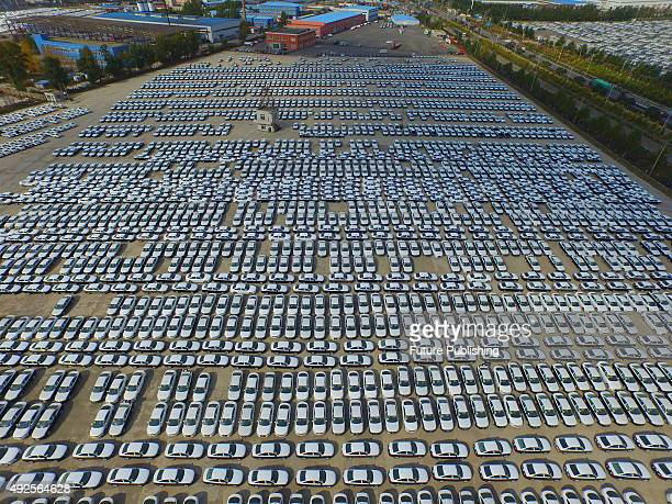 An aerial view of new cars in the parking lot of a major automaker on October 14 2015 in Changchun China Auto sales in China ended a fivemonth...