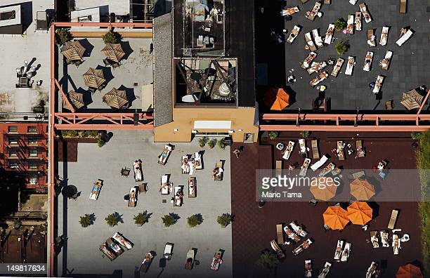 An aerial view of New Yorkers taking in the sun on Manhattan rooftops on August 4 2012 in New York City The past year through June 2012 in the...