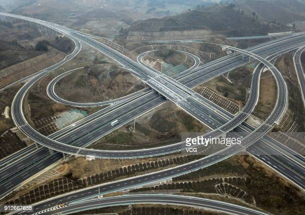 An aerial view of part of the AnshunZiyun expressway is seen on January 30 2018 in Anshun China The 56km AnshunZiyun expressway in Southwest China's...