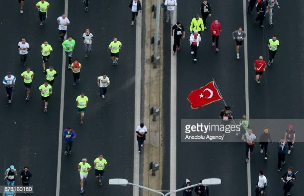 An aerial view of participants competing during Vodafone 39th Istanbul Marathon at The 15 July Martyrs Bridge in Istanbul Turkey on November 12 2017...