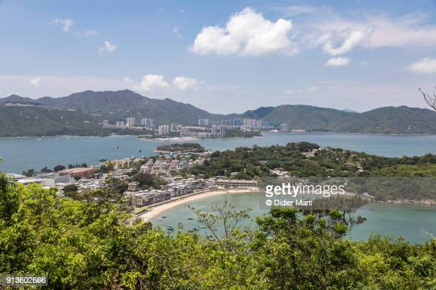 an aerial view of peng chau island, with lantau in the background, in hong kong on a sunny day. - lantau stock pictures, royalty-free photos & images