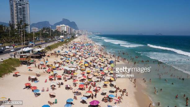 An aerial view of people enjoying the weather at Barra da Tijuca beach on December 20, 2020 in Rio de Janeiro, Brazil. According to the State...