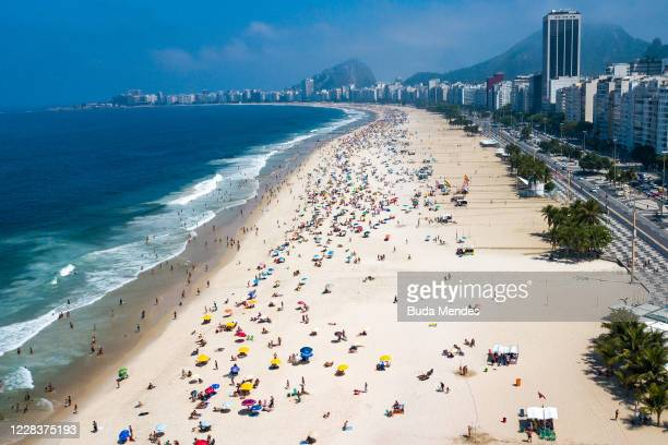 An aerial view of people enjoying the weather at Copacabana Beach on September 6, 2020 in Rio de Janeiro, Brazil. Residents of Rio de Janeiro and...