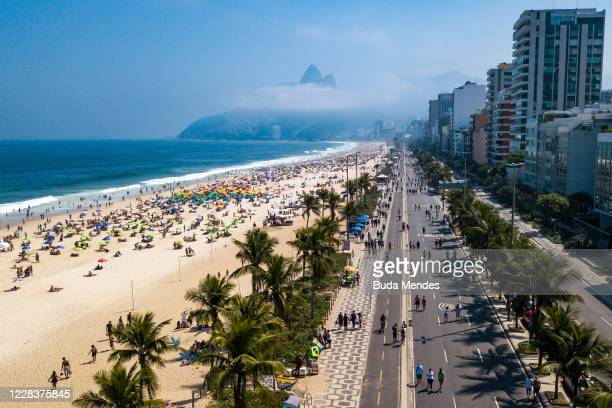 An aerial view of people enjoying the weather at Ipanema Beach on September 6, 2020 in Rio de Janeiro, Brazil. Residents of Rio de Janeiro and...
