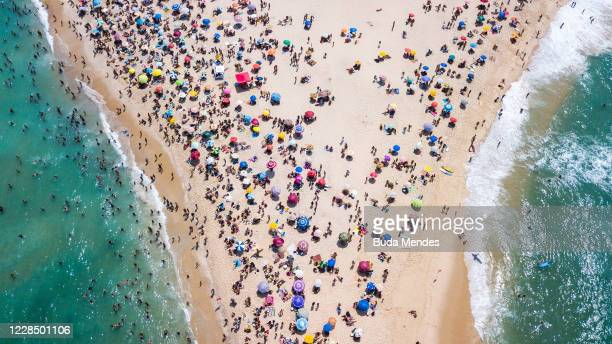 An aerial view of people enjoying the weather at Recreio and Pontal beach amidst the coronavirus pandemic on September 13, 2020 in Rio de Janeiro,...