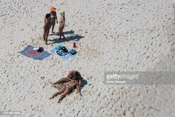 An aerial view of people enjoying the weather in Copacabana beach during a partial lockdown on March 26, 2021 in Rio de Janeiro, Brazil. The state of...