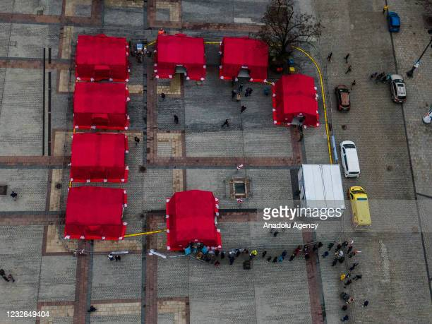An aerial view of people line up to receive a Johnson & Johnson covid-19 vaccine at Krakow's UNESCO listed Main Square on May 02, 2021 in Krakow,...