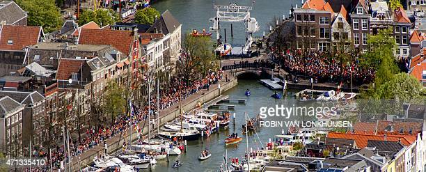 An aerial view of people looking at a boat transporting the Royal family on the Dutch canals in Dordrecht on April 27 during King's Day AFP PHOTO /...