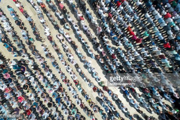 An aerial view of people performing the funeral prayer in absentia for former President of Egypt Mohamed Morsi at Fatih Mosque in Istanbul Turkey on...