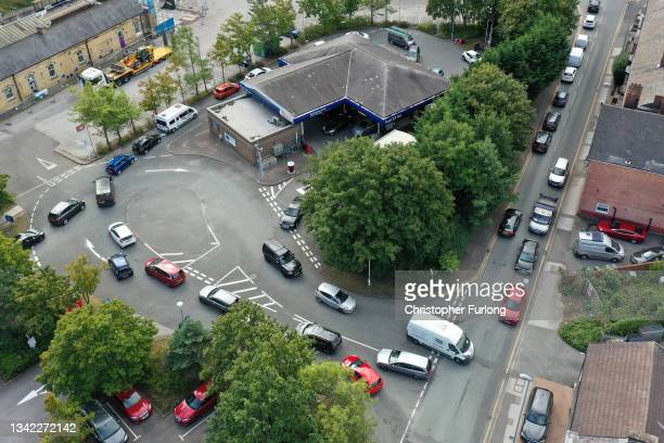 An aerial view of people queuing for petrol and diesel at a Tesco's Supermarket on September 24, 2021 in Northwich, United Kingdom. BP and Esso have...