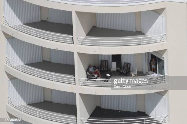 An aerial view of people sitting on their balcony following Hurricane Dorian on September 4 2019 in Freeport Bahamas A massive rescue effort is...