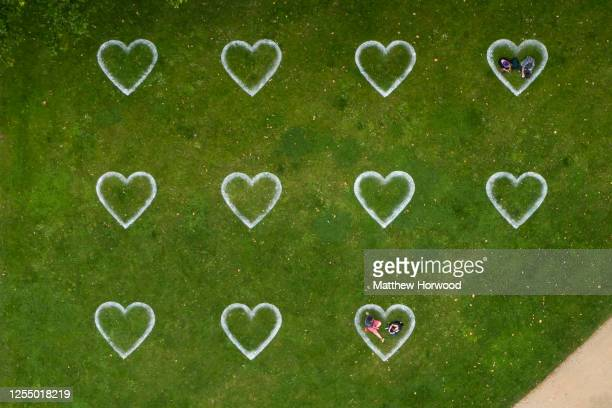 An aerial view of Queen Square where hearts have been sprayed onto the grass in an effort to encourage social distancing on July 8, 2020 in Bristol,...