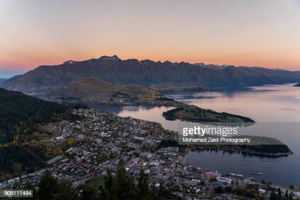 An aerial view of Queenstown downtown at dusk, South Island, New Zealand. Long exposure.
