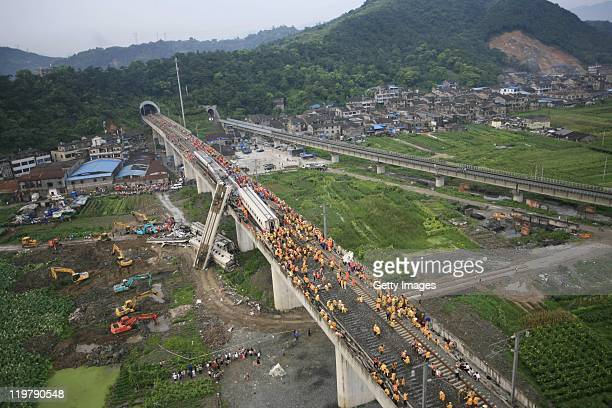 An aerial view of rescuers working around the accident site where two trains had collided on a bridge on July 24 2011 in Wenzhou Zhejiang Province of...