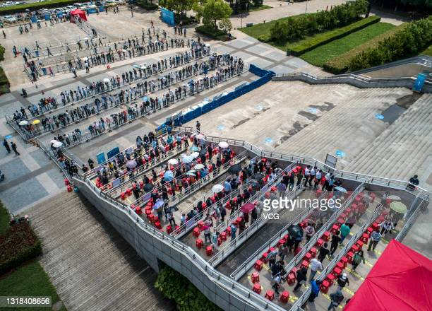 An aerial view of residents queuing up to receive COVID-19 vaccines at Hefei Olympic Sports Center on May 17, 2021 in Hefei, Anhui Province of China.