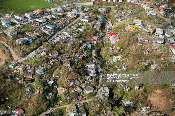 TOPSHOT An aerial view of Roseau capital of the Caribbean island Dominica shows destruction September 21 three days after passage of Hurricane Maria...