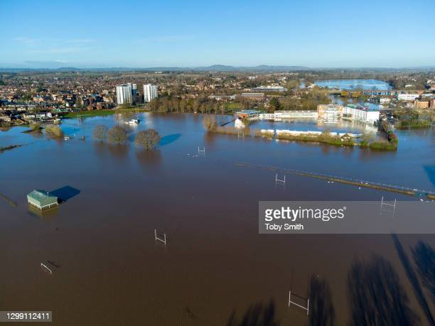 An aerial view of rugby pitches in front of frame and Worcestershire County Cricket Club back right of frame submerged by flood water on January...