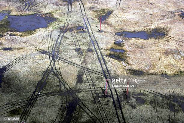 An aerial view of ruts of geological survey's crosscountry vehicles at the middle of a tundra in West Siberia near Novy Urengoy taken 17 June 2006...