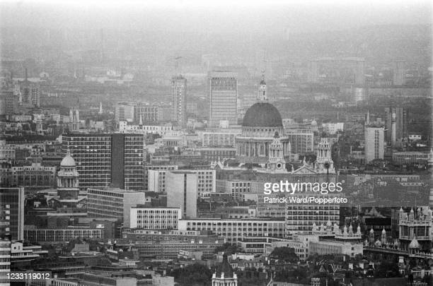 An aerial view of Saint Paul's Cathedral surrounded by office and tower blocks in central London, circa July 1969. From a series of images to...