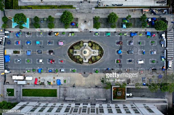 An aerial view of San Francisco's first temporary sanctioned tent encampment for the homeless on May 18, 2020 in San Francisco, California. After...