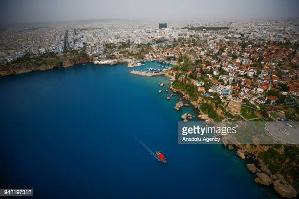 An aerial view of sea cliffs between two main beaches of the city Konyaalti Beach and Lara Beach in Antalya Turkey on April 01 2018 Turkey's tourism...