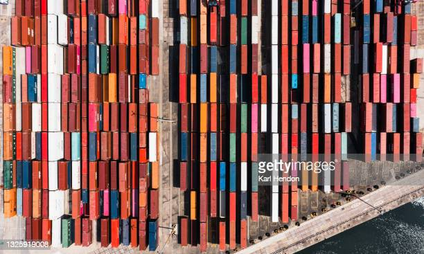 an aerial view of shipping containers stacked up in a port - stock photo - southampton england stock pictures, royalty-free photos & images