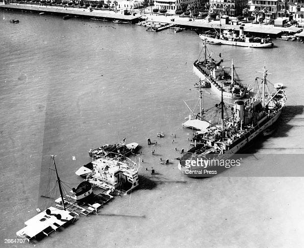 An aerial view of ships which have been sunk at the entrance to the Suez Canal to prevent passage during the Suez crisis On the right is an Naval...