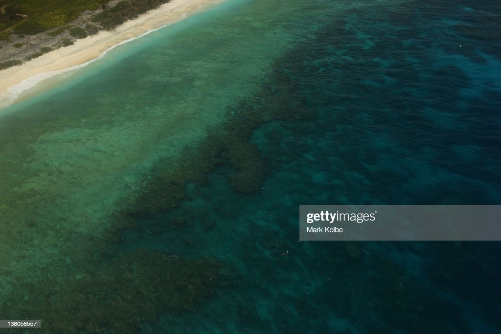 An aerial view of snorklers are seen exploring the reef on January 14, 2012 on Lady Elliot Island, Australia. Lady Elliot Island is one of the three island resorts in the Great Barrier Reef Marine Park (GBRMPA) with the highest designated classification of Marine National Park Zone by GBRMPA. The island of approximately 40 hectares lies 46 nautical miles north-east of the Queensland town of Bundaberg and is the southern-most coral cay of the Great Barrier Reef.