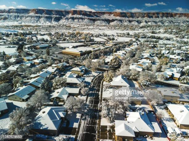 an aerial view of snowy rooftops of houses in a newer established subdivision early winter morning photo series - eyecrave  stock pictures, royalty-free photos & images