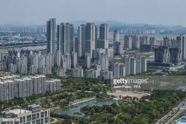 An aerial view of Songdo City, pictured through a window of Oakwood Premier Hotel on May 21, 2017 in Incheon, South Korea.