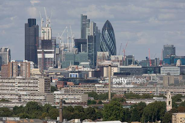 An aerial view of south London looking from Camberwell towards the City the financial centre Fastrising towers and the newest office blocks climb...