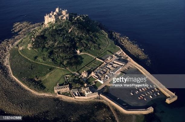 An aerial view of St Michael's Mount with its castle, church and harbour, an island off the Cornish coast near Penzance in the care of the National...