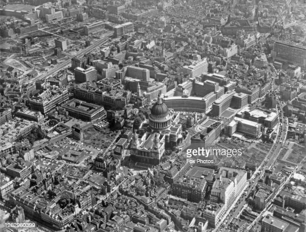 An aerial view of St Paul's Cathedral in the City of London, with the new Route 11 and Queen Victoria Street on the right, 8th July 1959.