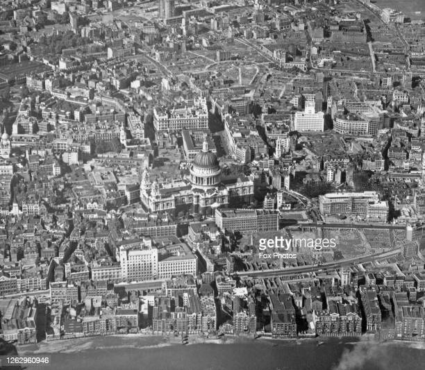 An aerial view of St Paul's Cathedral in the City of London with the River Thames in the foreground August 1955
