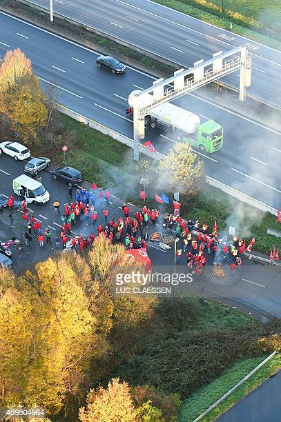 An aerial view of strikong workers at the harbour during a strike in the Antwerp province on November 24 2014 The different unions called for strikes...