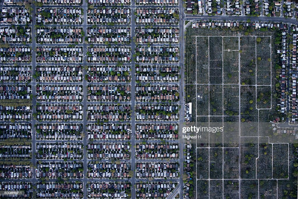 An aerial view of suburbian housing and cemetery : Stock Photo